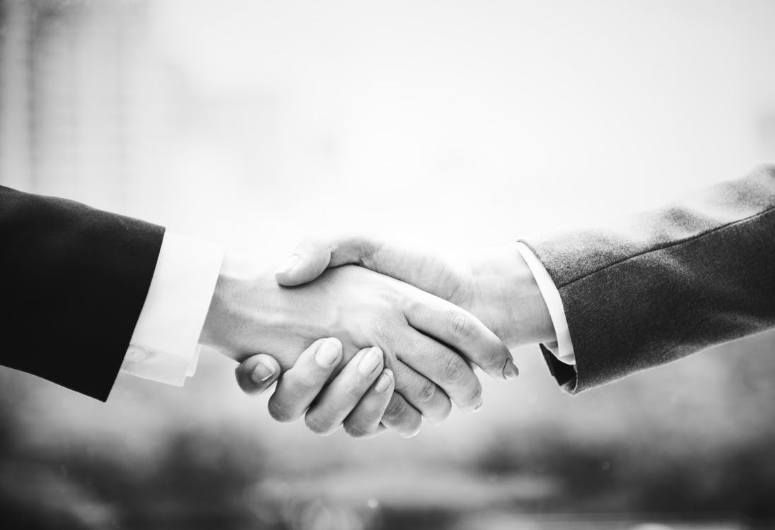handshake in black and white